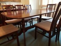 Beautiful Mahogany Dining Table and 8 matching chairs.