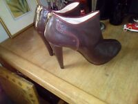 Leather boots which fasten with a zip at the heel. Brand new but without a box.