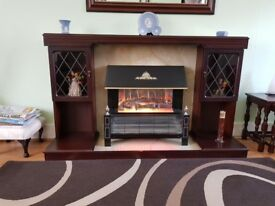 Free standing electric fire with surround