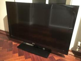 LG black television tv with remote can deliver