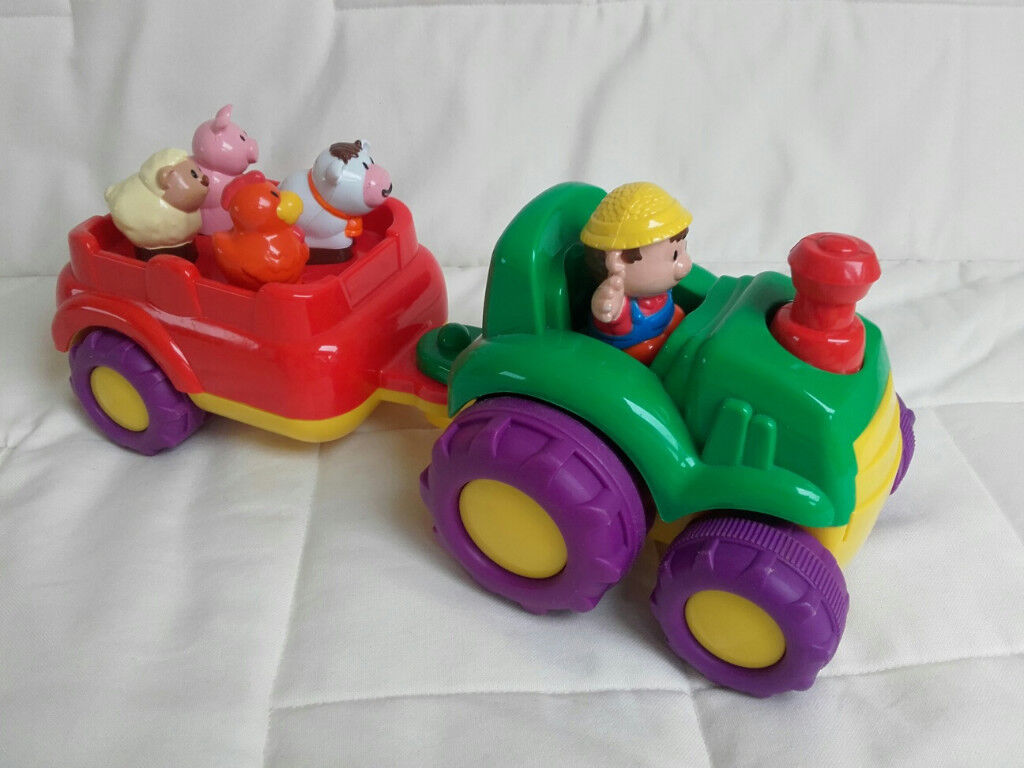 Toddler sounds toy – farmyard tractor and figures.