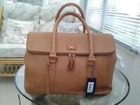 Designer handbag in luxury nubuck leather, brand new with tags
