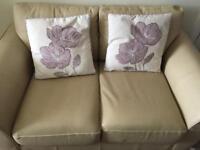 Stunning leather cream 2 seater sofa