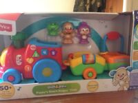 Fisher Price Laugh and Learn - Puppy's Smart Stages Train. Brand new boxed toy