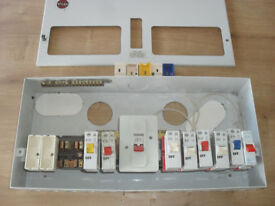 consumer unit older style with circuit breaker fuses