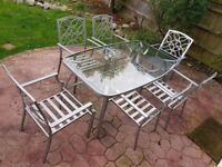 GLASS and METAL GARDEN TABLE and 6 CHAIRS