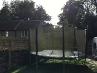 Free !!!!! 12ft trampoline signs of use, dent on the frame but in full working order