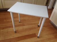Vintage coffee / side table, smart looking, painted satin white with original black castors