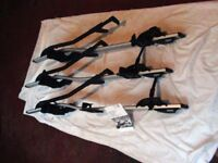Genuine BMW cycle racks x3, roof mounted. Used. Fit all BMW roof bars and many others too