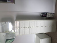 Tall swivel bedroom cabinet with mirror