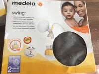 Medela electric pump with additional bottle