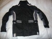 Crane Armoured motorbike jacket, used but good useable condition. MEDIUM SIZE LOOK!!!