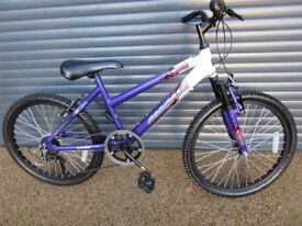 GIRLS MAGNA FRONT SUSPENSION BIKE IN IMACULATE CONDITION. IDEAL GIFT. (SUIT APPROX. AGE. 8 / 9+)..