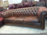 Large three setter brown leather chesterfield.