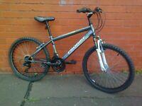 ProBike Mountain Bike - Front suspension , comfortable seat , good brakes , ready to ride .