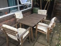 Garden table with 4 chairs (incl chair covers)