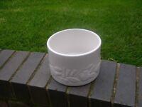 An attractive white ceramic planter.