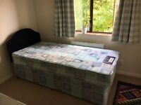 Single divan bed with matress, two drawers and headrest.