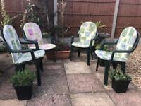 Four garden chairs with seat cushions