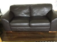 2 seater very dark brown leather sofa in good condition