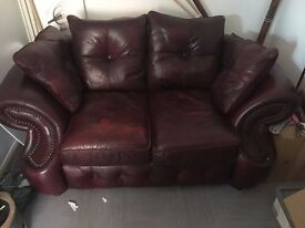 Leather red 2 seater sofa. Very good condition.