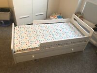 Toddler bed with storage drawer