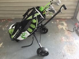 Set of junior golf clubs and trolley