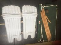 Cricket equipment - Pads, stumps and a cricket ball and original old cricket bag/ used