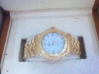 Diamond Ebel watch set in 18kt gold gents or lady's watch,as new,fully serviced and polished