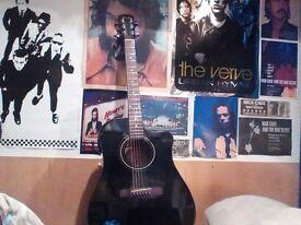 Fender Cd60 ce black acoustic guitar.