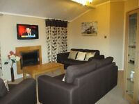 HAGGERSTON, ROOMY LUXURY LODGE, 2 BEDROOM, 2 BATH + SOFABED IN LOUNGE, CH, DG, DISHWASHER ETC + DECK