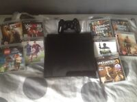 PlayStation 3(PS3) slim 150GB console with wireless controller and a range of games