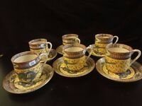 Set of Six Chinese coffee cans and saucers with yellow ground and dragon decor