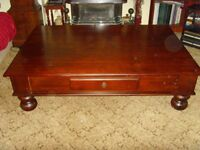 Large Mahogany colour coffee table with chunky ball feet.