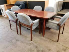 Large meeting room table with 6 chairs