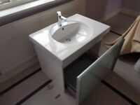 Large bathroom sink with tap and under storage drawer