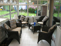 Five piece conservatory suite comprising of settee, three chairs and coffee table.