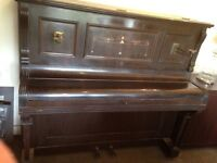 Upright antique piano collectible in need to TLC