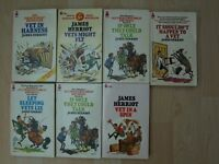 A collection of 7 James Herriot Paper backs