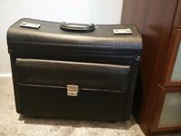 Business pilot case on wheels, imitation leather and hardly used.