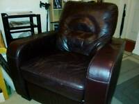 Large leather electric reclining chair.