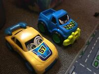 2 large toys r us cars