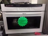 Combination microwave grill oven integrated