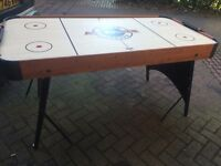 Air Raider air hockey table- fold up- in need of some cleaning and fixing, but works well.