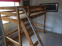 Child's Flexa cabin bed with mattress, bookshelves and table