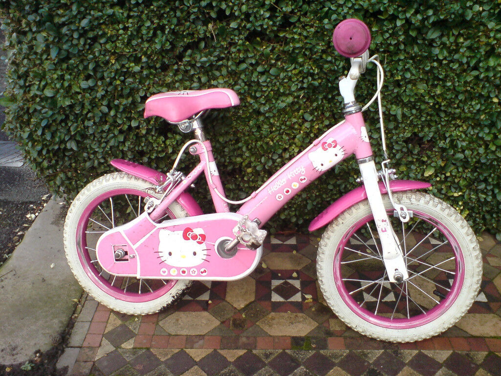 SMALL PINK KIDS BIKE AND SAFETY HELMET