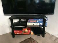 Black glass and chrome TV stand - perfect for any size