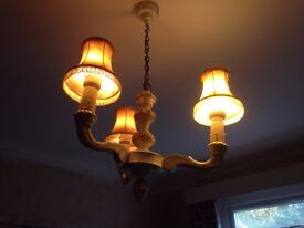 wooden 3 arm light fitting on a chain.