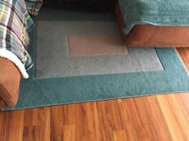 Rug in teal and grey