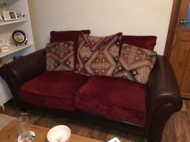 Beautiful condition 2 seaters x 2 .. with a wooden frame